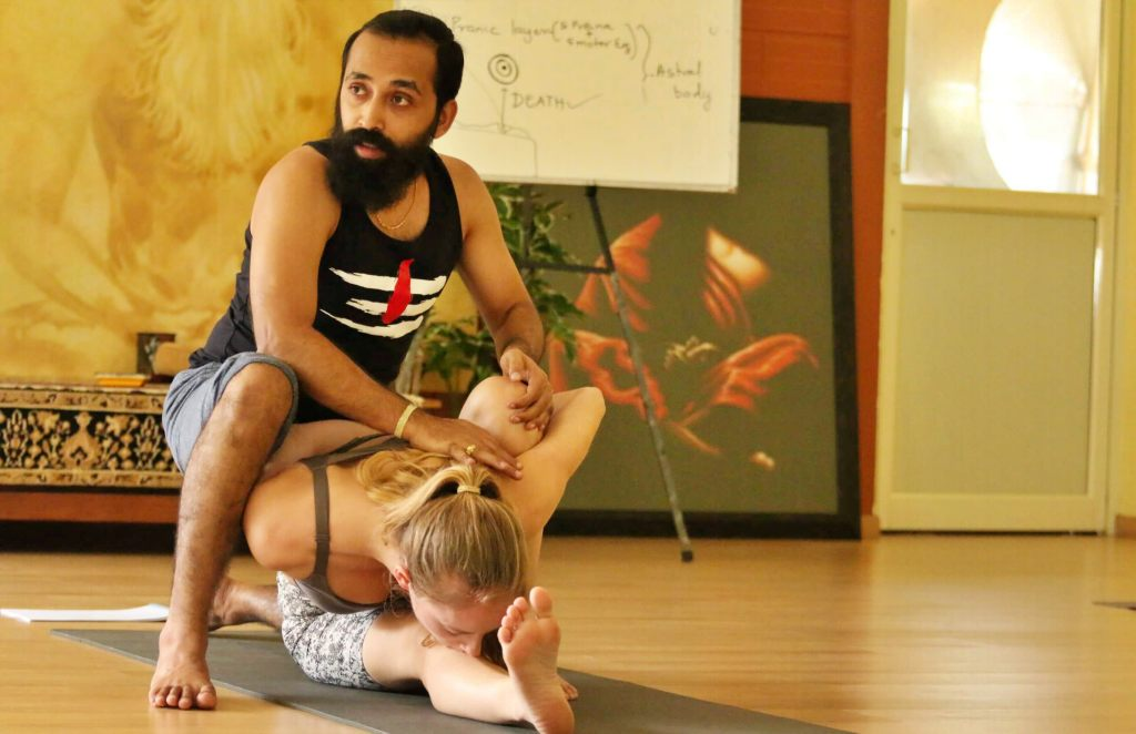Hands on Adjustments in Asanas